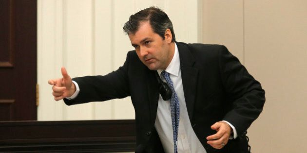 Former North Charleston police officer Michael Slager gestures as he testifies in his murder trial at...