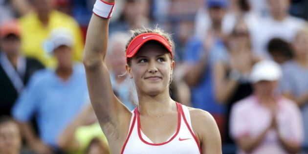 Eugenie Bouchard of Canada waves to the crowd after defeating Dominika Cibulkova of Slovakia in their...