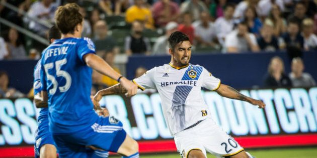CARSON, CA - SEPTEMBER 12: A.J. DeLaGarza #20 of Los Angeles Galaxy takes a shot on goal during Los Angeles...