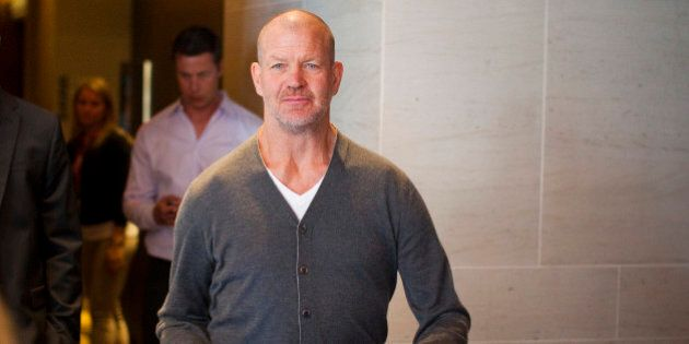 Lululemon Athletica Inc's founder Chip Wilson arrives for the company's annual general meeting in Vancouver...