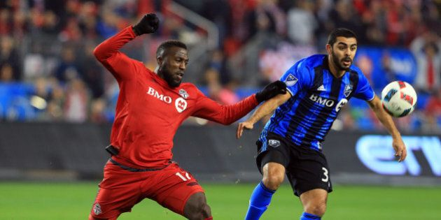 TORONTO, ON - NOVEMBER 30:  Jozy Altidore #17 of Toronto FC battles for the ball with Hernn Bernardello #30 of Montreal Impact during the first half of the MLS Eastern Conference Final, Leg 2 game at BMO Field on November 30, 2016 in Toronto, Ontario, Canada.  (Photo by Vaughn Ridley/Getty Images)