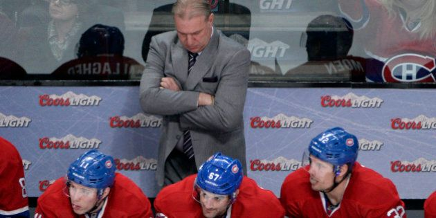 Jan 25, 2014; Montreal, Quebec, CAN; Montreal Canadiens head coach Michel Therrien behind Brendan Gallagher...