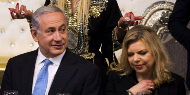 Israeli Prime Minister Benjamin Netanyahu (L) and his wife Sara (R) attend the Mimona ceremony at the...