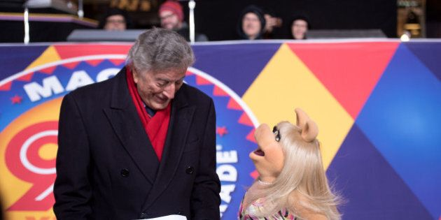 NEW YORK, NY - NOVEMBER 22:  Singer Tony Bennett and Miss Piggy perform at the 90th anniversary Macy's Thanksgiving day parade rehearsals at Macy's Herald Square on November 22, 2016 in New York City.  (Photo by Noam Galai/WireImage)