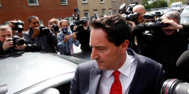 Montreal mayor Michael Applebaum is surrounded by media as he leaves the Surete du Quebec headquarters...