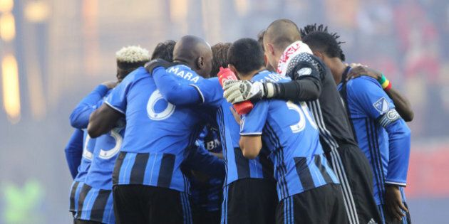 HARRISON, NEW JERSEY- November 06: The Montreal team embrace before the start of the New York Red Bulls...