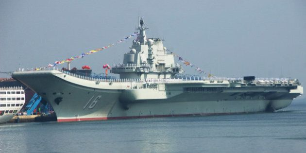 DALIAN, CHINA - SEPTEMBER 25: (CHINA OUT) China's first aircraft carrier, named 'Liao Ning', docks at...