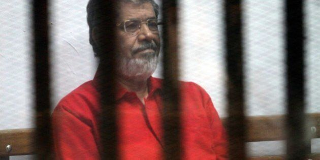 CAIRO, EGYPT - JUNE 18: Egypts ousted President Mohamed Morsi is seen behind the bars during his trial...