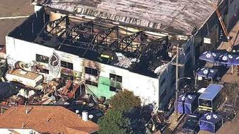 FILE - This Dec. 3, 2016, file image from video provided by KGO-TV shows the Ghost Ship Warehouse after a fire swept through the building in Oakland, Calif. A Northern California judge has barred lawyers from publicly discussing the case of two men each charged for their role with the warehouse illegally converted into an entertainment venue where a fire killed three dozen concert-goers. Judge Trina Thompson on Friday, Jan. 18, 2019, granted a prosecutors' request to silence the defendants' lawyers outside court. (KGO-TV via AP, File)