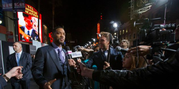 Cast member Will Smith is interviewed at the premiere