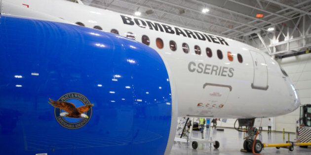 Bombardier's CS300 Aircraft, showing its Pratt & Whitney engine in the foreground, sits in the hangar...