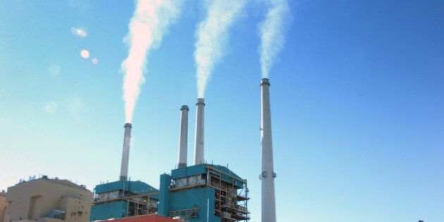 FILE - In this July 1, 2013, file photo, smoke rises from the Colstrip Steam Electric Station, a coal...