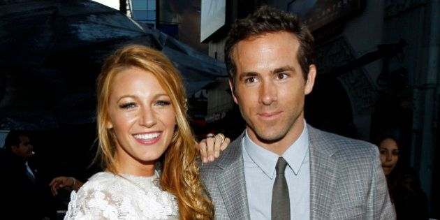 FILE - This June 15, 2011 file photo shows actors Blake Lively, left, and Ryan Reynolds at the premiere of