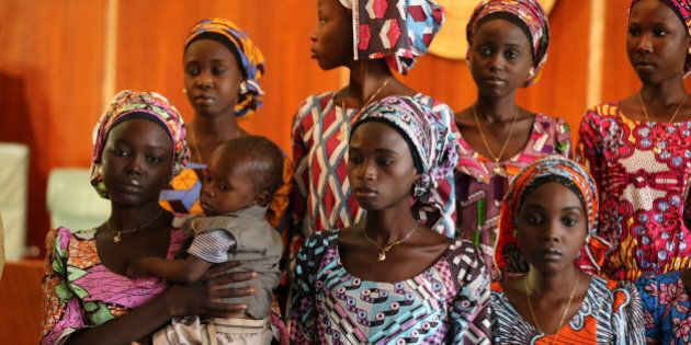 One of the 21 Chibok school girls released by Boko Haram carries her baby during their visit to meet...