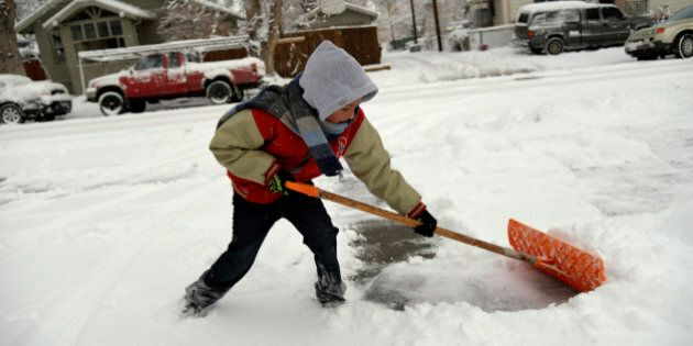 DENVER, CO. - February 26, 2015: Armando Uride 8, making the most of his snow day off from Beach Court...