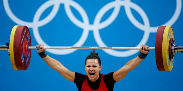 Canada's Christine Girard competes on the women's 63Kg weightlifting competition at the ExCel venue at...