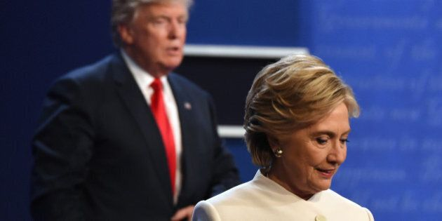 Democratic nominee Hillary Clinton (R) and Republican nominee Donald Trump walk off the stage after the...