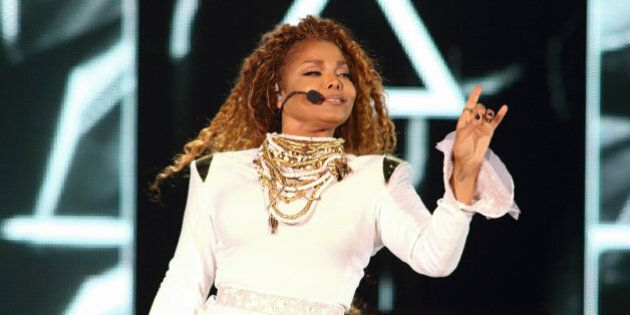 MIAMI, FL - SEPTEMBER 20: Janet Jackson performs on stage during her 'Unbreakable' World Tour concert...