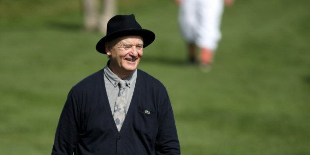 Feb 11, 2015; Pebble Beach, CA, USA; Film actor Bill Murray reacts to play on the seventeenth hole during...