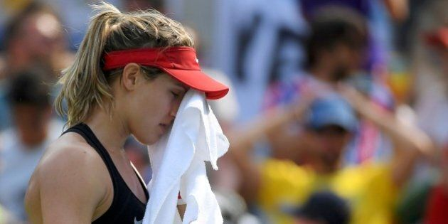 2016 Rio Olympics - Tennis - Preliminary - Women's Singles Second Round - Olympic Tennis Centre - Rio de Janeiro, Brazil - 08/08/2016. Eugenie Bouchard (CAN) of Canada wipes her face during her match against Angelique Kerber (GER) of Germany. REUTERS/Toby Melville FOR EDITORIAL USE ONLY. NOT FOR SALE FOR MARKETING OR ADVERTISING CAMPAIGNS.