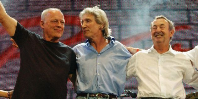 LONDON - JULY 2:  (EMBARGOED FOR PUBLICATION IN UK TABLOID NEWSPAPERS UNTIL 48 HOURS AFTER CREATE DATE AND TIME) (L to R) Musicians David Gilmour, Roger Waters, Nick Mason and Richard Wright of Pink Floyd stand on stage at 'Live 8 London' in Hyde Park on July 2, 2005 in London, England.  The free concert is one of ten simultaneous international gigs including Philadelphia, Berlin, Rome, Paris, Barrie, Tokyo, Cornwall, Moscow and Johannesburg. The concerts precede the G8 summit (July 6-8) to raising awareness for MAKEpovertyHISTORY.  (Photo by Dave Benett/Getty Images)