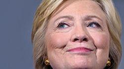 Clinton tente de panser les plaies de la communauté
