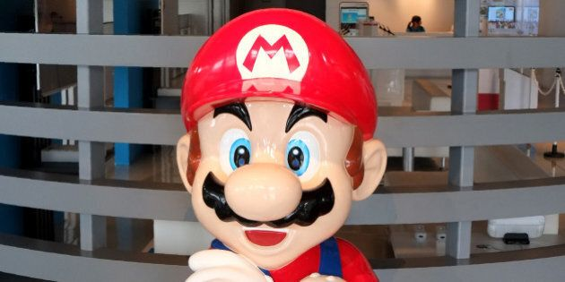The logo of Japanese gaming giant Nintendo and its game character Super Mario are displayed at a show...