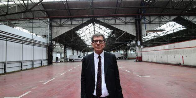 Pompidou centre president Serge Lasvignes poses inside a former Citroen garage after unveiling a project...