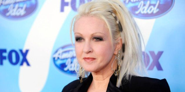 Cyndi Lauper poses for photographers at the finale of Season 8