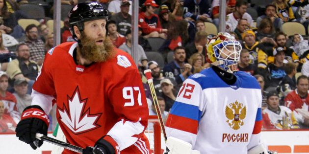 Team Canada's Joe Thornton (97) skates in front of Team Russia goalie Sergei Bobrovsky (72) during the second period of a World Cup of Hockey 2016 exhibition game in Pittsburgh Wednesday, Sept. 14, 2016. Canada won in overtime 3-2. (AP Photo/Gene J. Puskar)