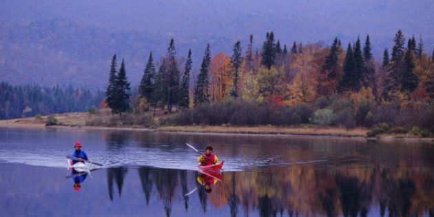 QUEBEC, CANADA - 1992/10/15: People kayaking in the fall on Lake Lac-Monroe, Mont-Tremblant National...