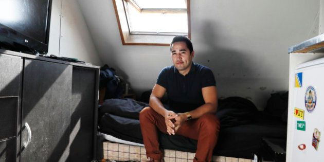 Ivan Lopez poses at his home, a less than 7 square meter apartment in the 5th district of Paris, on September...