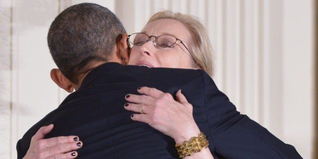 US President Barack Obama hugs actress Meryl Streep at the end of the Medal of Freedom ceremony in the...