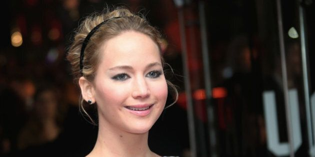 Actress Jennifer Lawrence poses for photographers upon arrival to the world premiere of the film The...