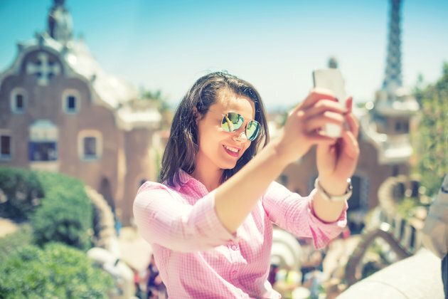 Attractive woman taking selfie with smart phone, mobile phone. Modern concept of photography, selfie,...