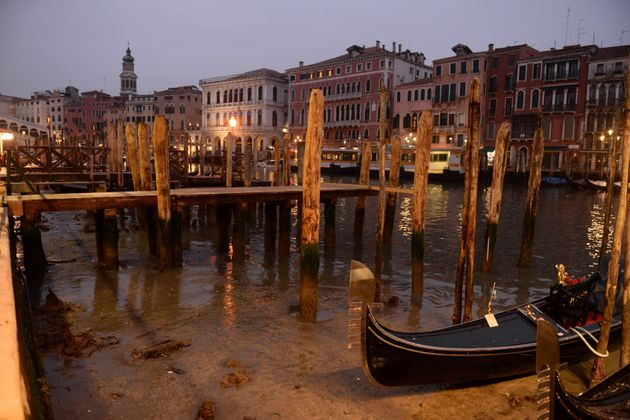 Gondolas are seen tied up in Venice Canal Grande, near Rialto bridge, on January 31, 2018, as exceptionally...