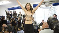 Les électeurs italiens au rendez-vous, une femen pour