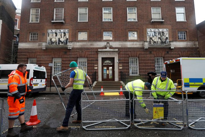 Workers build a media pen opposite the entrance to the Lindo Wing of St Mary's hosital where Britain's Catherine, The Duchess of Cambridge, is due to give birth to her third child, in London, April 9, 2018. REUTERS/Peter Nicholls - RC1C3F716100