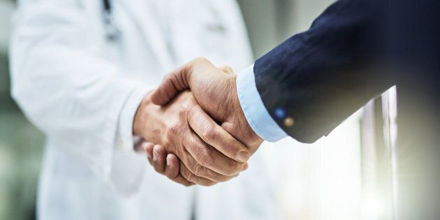 Cropped shot of a doctor shaking hands with a