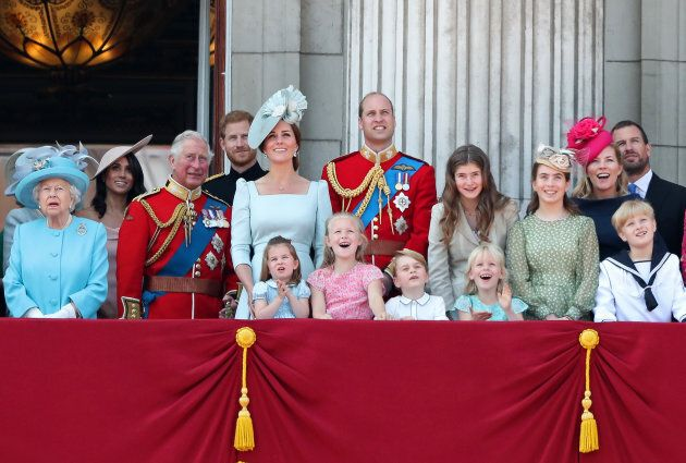 Members of the Royal Family stand on the balcony of Buckingham Palace during the Trooping the Colour...