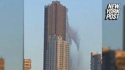 Une piscine sur le toit d'un gratte-ciel devient une impressionnante chute