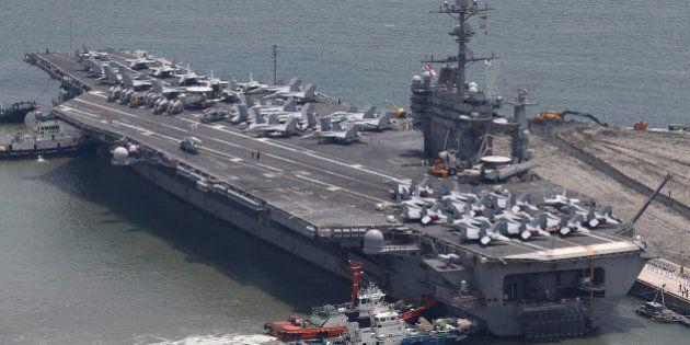 BUSAN, SOUTH KOREA - JULY 11: US aircraft carrier USS George Washington sits at anchor in Busan port...