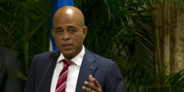 President Michel Martelly addresses a meeting of an advisory commission December 9, 2014 in Port-au-Prince....