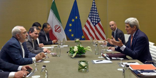 U.S. Secretary of State John Kerry, right, during official talks with Iranian Foreign Minister Mohammad...