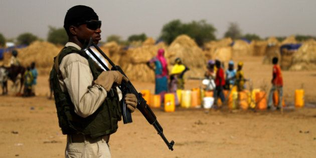 A Nigerien soldier stands guard in a camp of the city of Diffa during the visit of Niger's Interior Minister...
