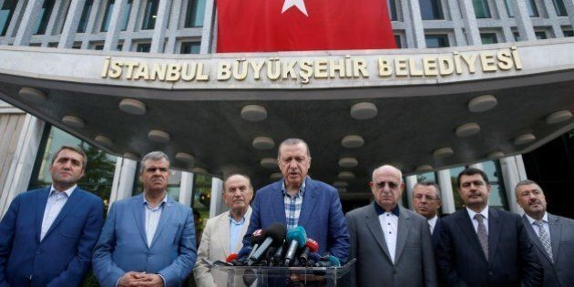 ISTANBUL, TURKEY - AUGUST 21: Turkish President Recep Tayyip Erdogan (C) speaks to media as Istanbul...