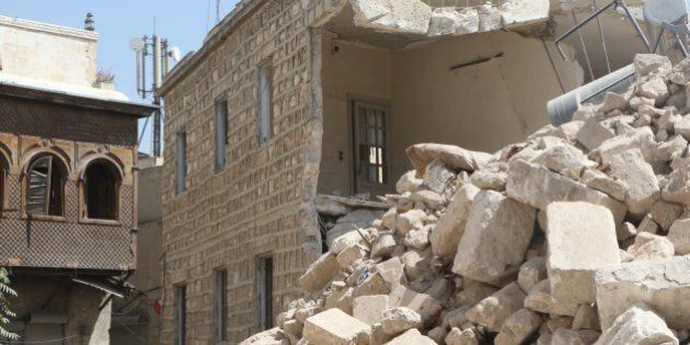 ALEPPO, SYRIA - AUGUST 20: Debris of a collapsed building is seen after war crafts belong to the Assad...