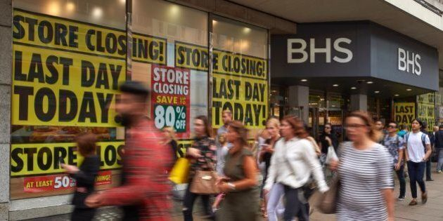 Pedestrians walk past retailer BHS (British Home Stores) flagship store on Oxford Street in central London...