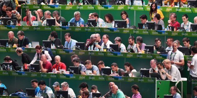 Journalists work ahead of the opening ceremony of the Rio 2016 Olympic Games at the Maracana stadium...