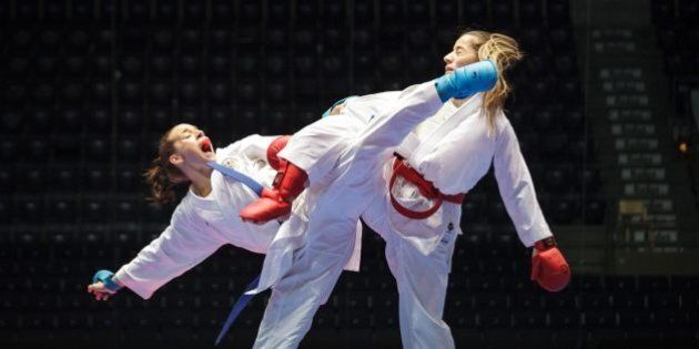 Serap Ozcelik of Turkey, right, and Austria's Bettina Plank in action during the women's Kumite -50 kg competition, at the Karate European Championship, Saturday May 3, 2014 in Tampere, Finland. Ozcelik won the gold medal.  (AP Photo/TT News Agency, Aleksi Tuomola) FINLAND OUT
